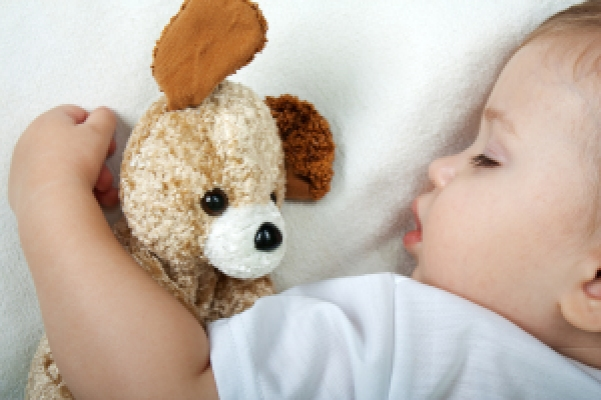 Little child sleeping in happiness and family love